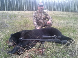 "Guiding Mike was about as easy as it gets.  Put him on a spot and stalk for a black bear and he takes this monster of near 450 pounds of spring bear.  Put him on another spot and he nails another good bear.  ""Nothing to this bear hunting up here"", he says as he admires his second bear even though this one took him most of a day of sitting.  2 great bear and a great guy to share a day of hunting with."