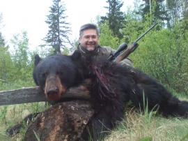 What a great guy.  Fernando came to camp with a smile and left with a smile.  A bit of finesse on this bear and he made no mistake about his chance for a trophy black bear.  His shot hit the bear dead on in the shoulders and his trophy bear hit the ground.  A few photos later and the bear was loaded and taken to camp for skinning and freezing.  Again, another spot and stalk for the best of bear hunting.