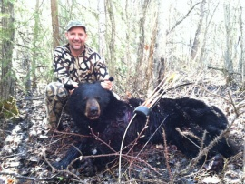 Chris brought his bow for his spot and stalk Alberta black bear hunt and he tagged this guy with a great shot after a bit of stalking within range.  A very good black bear for his trophy.  His second bear was a bit luckier but ended up wounded.  The shot that wasn't a fatal shot and the bear kept moving.  No amount of tracking could get the guide back onto this monster trophy.