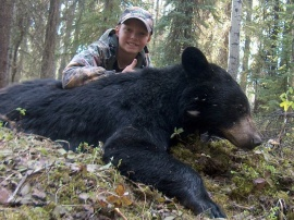Brad at 12 years took this trophy bear with dead on precision on his shot and not a moment too soon. While sitting with, Rick, his guide, this bear, part of a group of 4 bears turned to charge but Brad's bullet hit dead on and dropped his trophy on the spot. What a great new hunter to have in camp and his character and excitement each day was a highlight of the week.