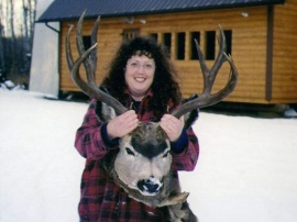 A late october mule deer packing 12 points on its 29 inch rack and scoring and impressive 175 points unofficial. Karen proudly displays this trophy buck in front of the camp kitchen.